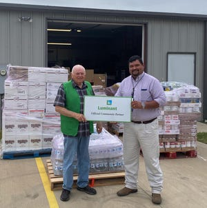 Patrick Allen, manager of Emergency Planning for Luminant, presented 2,000 pounds of food and water to Papa's Pantry on June 22. Luminant is a long time supporter of the Food Bank and food bank officials are very appreciative of their support. Accepting on behalf of Papa's Pantry is Dwight Taylor, director.