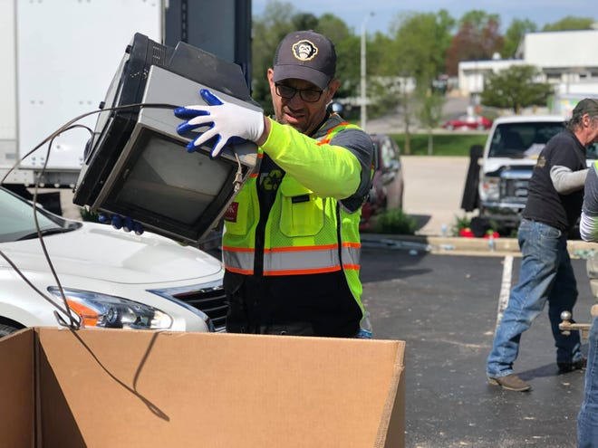 David St. John, manager of IT training at Cook, helps at the 2019  Community Electronic Recycling Day event. More than 70 people will be working to transfer electronics from vehicles to boxes that will be transported to RecycleForce in Indianapolis.