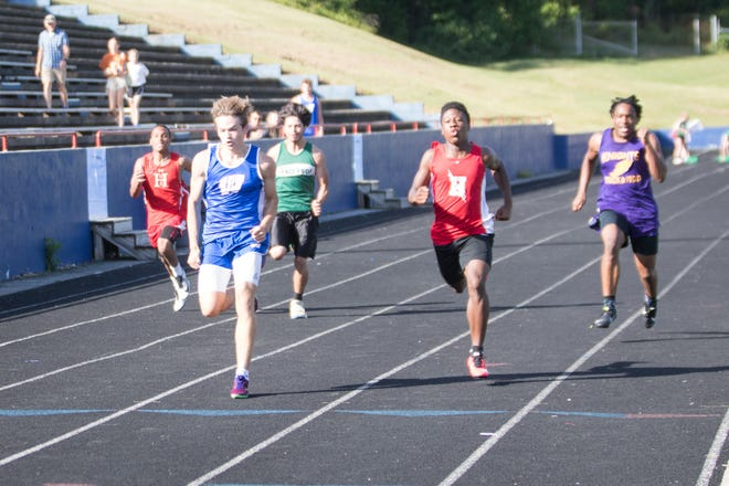 West Henderson's Brendan Henby crosses the line first to win the 100-meter dash at the Henderson County Championship meet earlier this season at West.