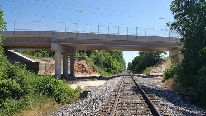 A trackside view of the completed 223-foot steel and concrete bridge on 43rd Avenue crossing the Union Pacific tracks.