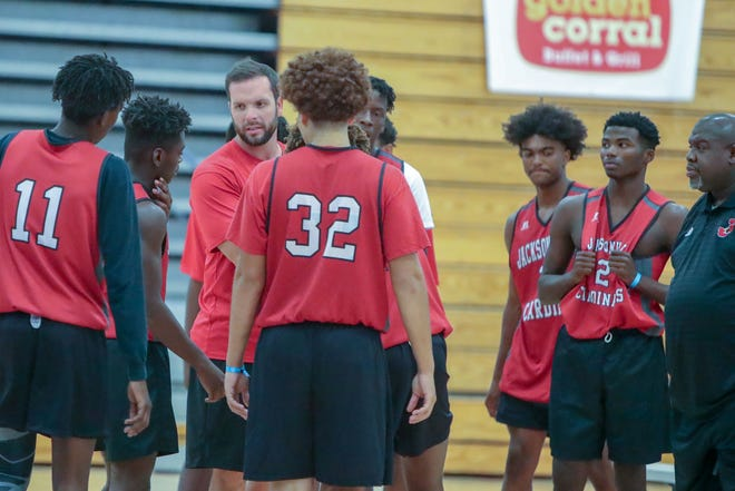 Jacksonville coach Sean Thompson talks to his team during a game in the 2019 East Coast Invitational. [Tina Brooks / The Daily News]
