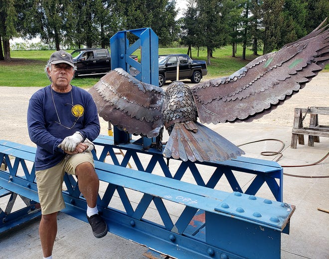 Jay Castro of Freeport sits next to part of the eagle project he welded at Highland  Community College in Freeport.