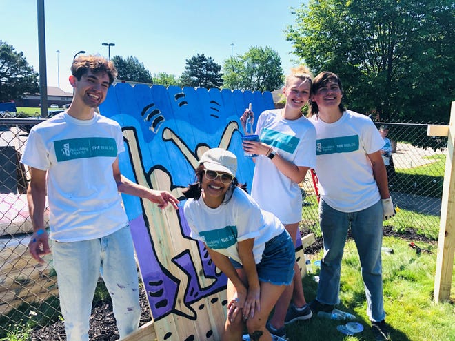 Maise Jones, Maliwan Rockland, Erin Brennan, and Henry Schuellerman, college students from Hudson, helped with a mural painting project.