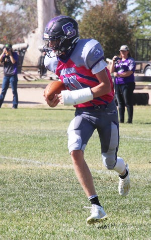 Cheraw High School's Trey Pearce runs with the ball after a reception in a game against Cotopaxi last October. Pearce will play in the 6-man football All-State Game on Sunday in Hugo.