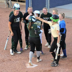 SMCC's Emily Theisen is greeted by her team after hitting a two-run home run in the sixth inning during the 2021 Monroe County All-Star Game on Tuesday, June 22, 2021 at Airport.
