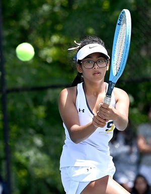 Shrewsbury freshman Aanya Gupta returns the ball during her third singles match against Westboro's Ellie King in the Division 1 Central final on Wednesday.