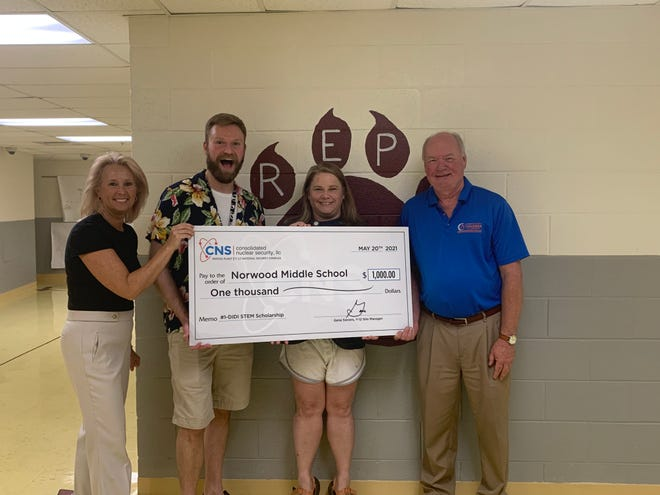 Kristin Waldschlager, left, CNS educational outreach specialist, presents a check to Norwood Middle School for winning first place in Anderson County Chamber of Commerce's annual 'Dream it. Do it.' competition. Also in the photograph are Norwood Middle School teacher Robert Stephan, from left, NMS Principal Shawna Woodruff and Anderson County Chamber of Commerce President Rick Meredith.