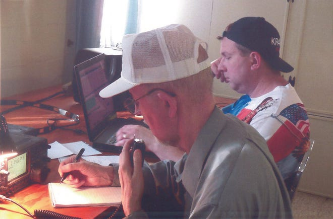 Father and son, Charles and Ross Hargis, operate an HF voice station during ARRL Field Day 2019.
