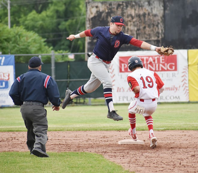 Oriskany Post's Colton Davis leaps for a throw to second as Utica Post's Joshua Duval makes it to second base during the third inning of District V Legion game Tuesday at Murnane Field in Utica. Duval also had an RBI in Utica's 5-1 win.