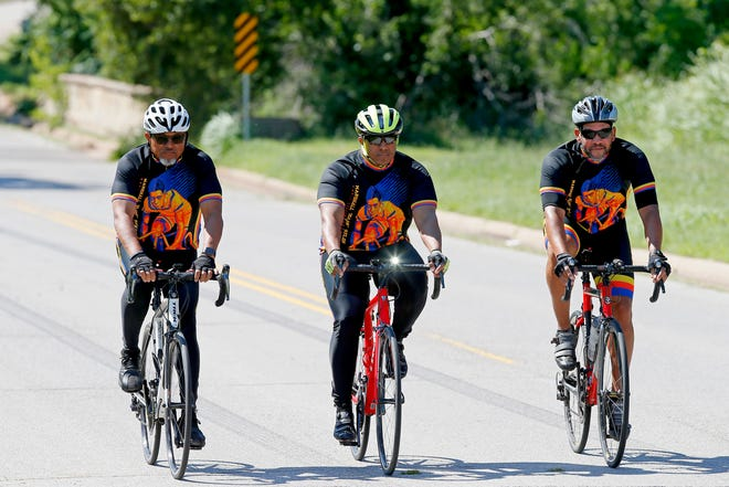 From left, Greg Woodson, Ivan Yelverton and Myron Knight ride their bikes Tuesday to promote the inaugural OKC Eastside Bike Ride.