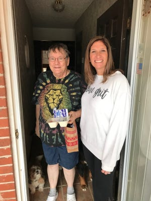 Edmond Mobile Meals volunteer Liz Haralson, at right, delivers a meal to a client.