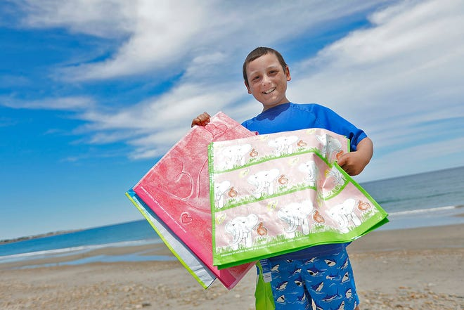 NEWWSMAKER Mateo Goldman,13 of Duxbury who has designed reusable shopping bags for HomeGoods stores as part of a Jimmy Fund fundraiser. He has been a cancer patient at the clinic.  Wednesday June 23, 2021 Greg Derr/The Patriot Ledger
