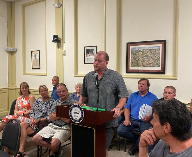 Rob Ficara, owner of Exeter Bowling Lanes and Shooters Pub, addressed the Select Board to request the town remove median islands at the intersection of Brentwood Road-Columbus Avenue and Epping Road, blocking traffic from Epping Road from accessing his business on Columbus.