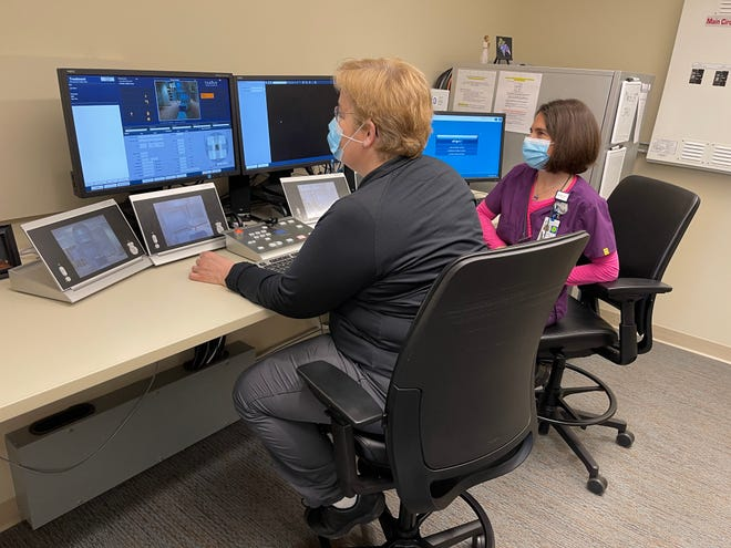 Technicians Holly and Connie in the control room of the linear accelerator where they can monitor the treatment procedure and can observe the patient.