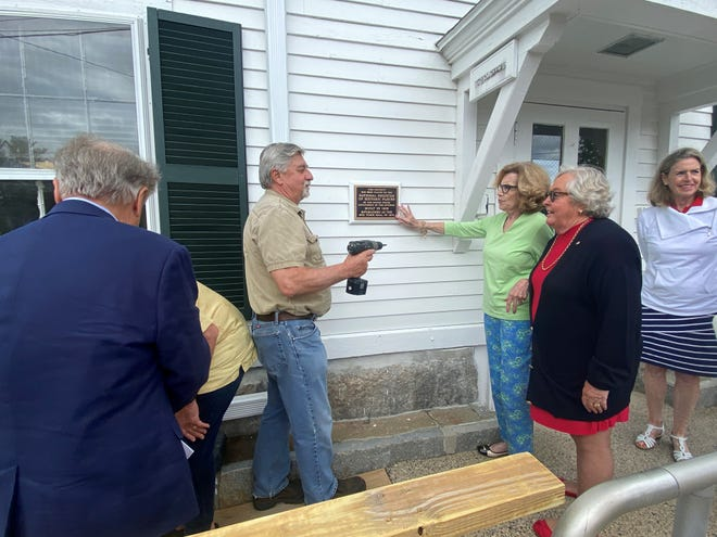 A plaque was placed on the Rye Old Town Hall during a ceremony recently after its designation as a National Historic Building by the Federal Registry of Historic Places.