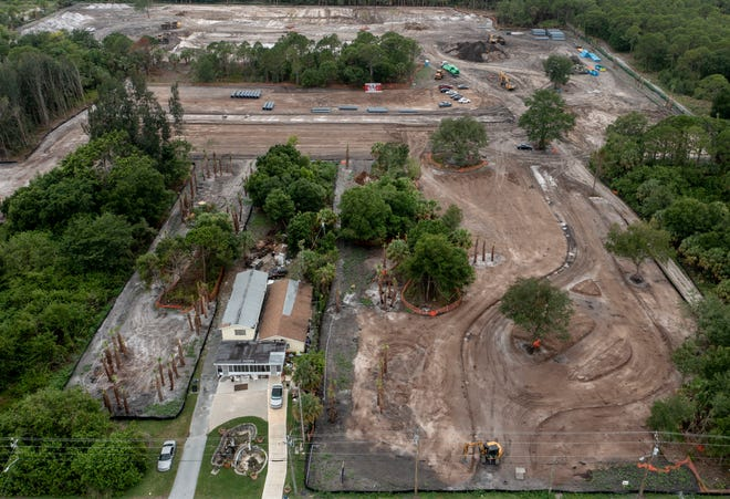 The Reserve at Jupiter development is being built next to Clara Barnes home on Limestone Creek Road on June 16, 2021 in Jupiter, Florida. 2021.