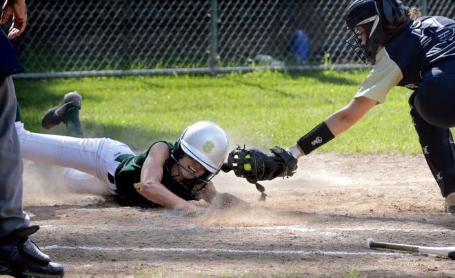 Smithfield's Lauren Boyd slides under the glove of Bay View catcher Abbie Green-Sermak to score for the Sentinels in the third inning of Wednesday's Division II playoff game.