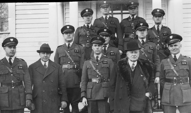 Gov. Aram J. Pothier, bottom row, second from right, visits state police troopers in North Scituate on Dec. 15, 1925.