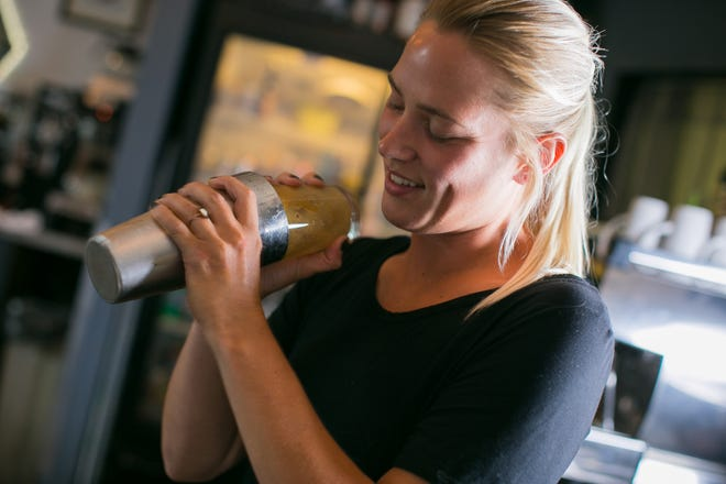 Alyssa Morris, server and bartender at Octane RKFD, prepares an espresso martini at the bar on Tuesday, June 22, 2021, in Rockford. A new state law lets bars and restaurants offer a free drink to people who get their COVID-19 vaccine, but not many local businesses are participating.
