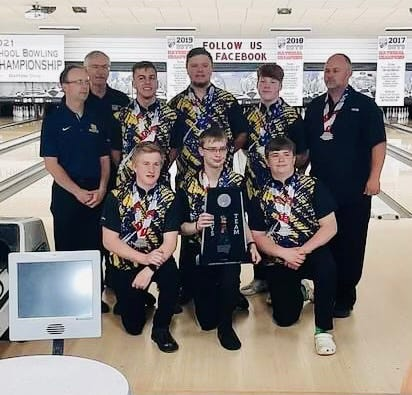 The Hononegah boys bowling team, along with head coach Brad Sommer, top right, pose with the second-place trophy after the U.S. High School Bowling National Championships ended in Dayton, Ohio, on Sunday, June 20, 2021.