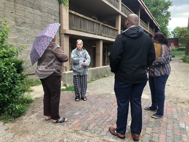 Officials with the South Bend Housing Authority speak Wednesday morning about housing options with tenant Ruth Dorbin at Kamm's Island Apartments in Mishawaka.
