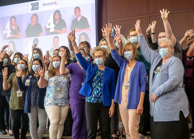 Marsha Prater, senior vice president and chief nursing officer of Memorial Medical Center, center, is joined by her colleagues as they celebrate Memorial Medical Center receiving the American Nurses Credentialing Center's Magnet Recognition for Excellence in Nursing Services designation for the fourth time in a row at the Memorial Center for Learning and Innovation in Springfield, Ill., Wednesday, June 23, 2021. The Magnet Recognition for Excellence in Nursing Services is the highest honor a healthcare organization can attain for nursing excellence. [Justin L. Fowler/The State Journal-Register]