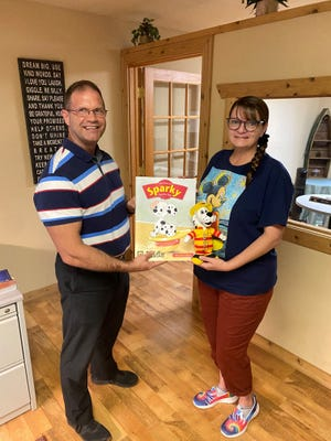 State Farm Agent Dennis recently donated a Sparky the Fire Dog education kit to special education teacher Christina Heck from Horace Mann Elementary School.