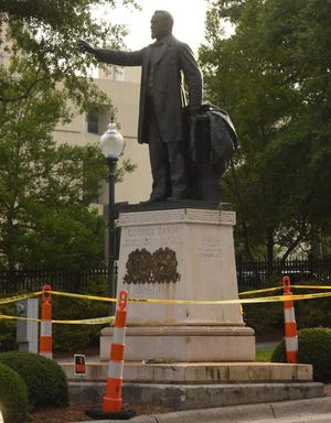 The statue of Confederate Attorney General George Davis at Market and Third streets in Wilmington on June 23, 2020. Two days later, the statue, and a Confederate memorial at Third and Dock streets, were removed, but the bases remain covered in canvas. On Monday, Wilmington City Council voted to permanently remove the statues.
