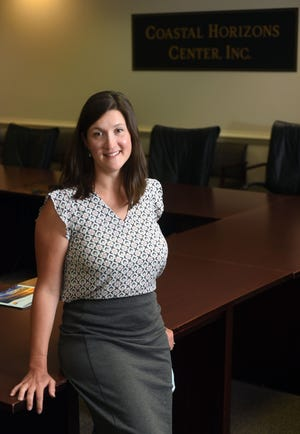 Jessica Canavan, Assistant Director of Community Based Family Services at Coastal Horizons, in the boardroom at the non-profit in Wilmington, N.C., Wednesday, June 23, 2021. Canavan is one of the StarNews 40 Under 40 honorees for 2021. [
