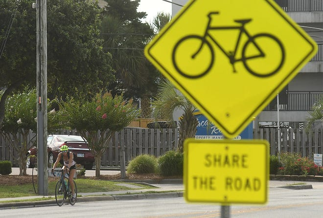 Bikes travel along Causeway Drive in Wrightsville Beach on Wednesday. The Wrightsville Beach Board of Aldermen also recently adopted a conceptual plan that would add bike paths to Causeway Drive. [KEN BLEVINS/STARNEWS]