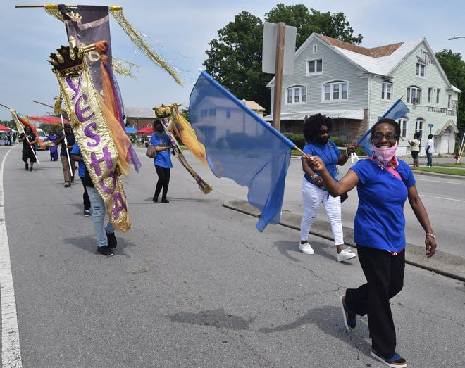 The Juneteenth Festival included a walking parade along Broad Street in the Five Points business district.