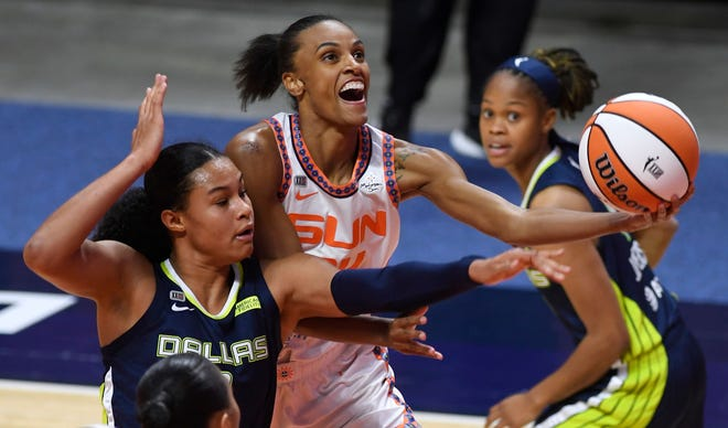Connecticut Sun forward DeWanna Bonner is fouled on a drive by Dallas Wings forward Satou Sabally during the Sun's 80-70 win at Mohegan Sun Arena in Uncasville, Conn.