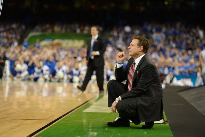 Bill Self, front, and the Kansas Jayhawks will take on John Calipari, background, and the Kentucky Wildcats during the 2022 Big 12/SEC Challenge on Jan. 29 at Allen Fieldhouse in Lawrence.