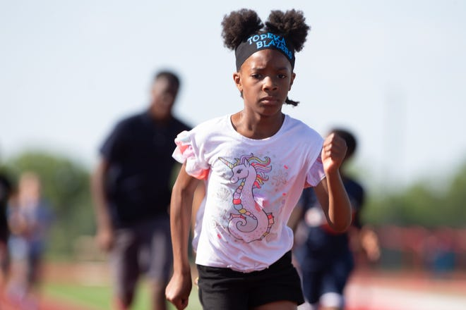 Quor'Vae Hailey practices her running technique Tuesday at Shawnee Heights. Hailey had the nation's fastest time in the 100 meters for a 7-year-old this year: 14.41 seconds.