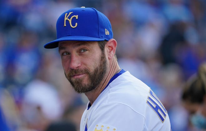 Kansas City Royals relief pitcher Greg Holland talks with teammates in the dugout June 6 before the game against the Minnesota Twins at Kauffman Stadium in Kansas City, Mo.