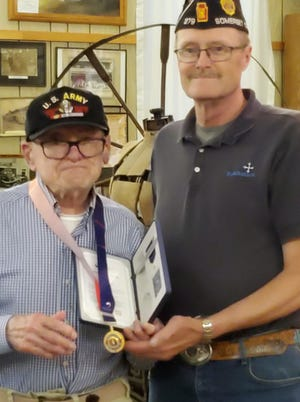 Thomas E. Bitner was honored at the meeting of the Rockwood Area Historical & Genealogical Society on June 1when the president of the society and Somerset County American Legion Cmdr. Kirk Moore presented Bitner with the Ambassador for Peace Medal. This was given by the Republic of Korea, for their gratitude for his service in the Korean War. Bitner has been a member of the Ligonier American Legion Post 267, but is a resident of Rockwood area at present.