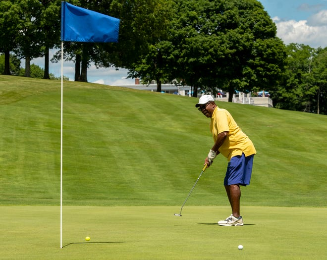 Ken Malcolm watches his putt on a green at Green Hill Golf Course on Wednesday in Worcester.