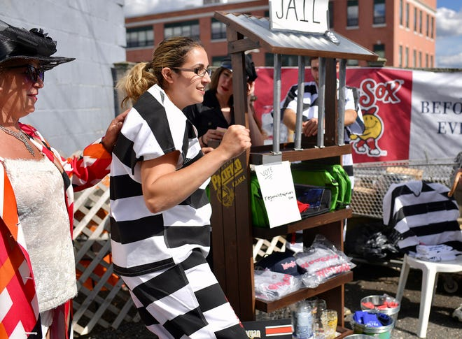 """Bree Allard dances after getting """"out of jail"""" at a Monopoly-themed party Wednesday at Ralph's Tavern on Shrewsbury Street."""