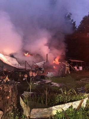 A mobile home went up in flames and was destroyed Tuesday evening, Alachua County Fire Rescue officials said. A man shot by Alachua County Sheriff's deputies died in the blaze, but his cause of death is uncertain.  [Alachua County Fire Rescue]