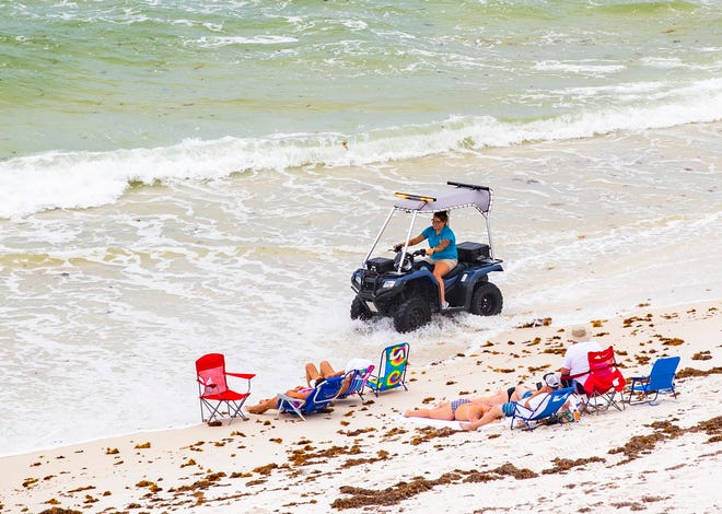 Beach Safety workers in Panama City Beach were busy Tuesday trying to keep people out of the Gulf because of dangerous rip tide conditions. The stretch of beach photographed was just west of the M.B. Miller County Pier.
