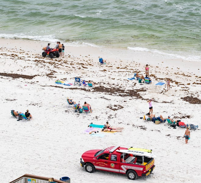 Beach Safety workers in Panama City Beach were busy in June trying to keep people out of the Gulf because of dangerous rip currents. The stretch of beach photographed was just west of the M.B. Miller County Pier.