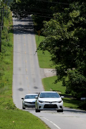 Motorists drive along Fort Smith's Country Club Drive in the 3200 block, an area where residents want something done to decrease speeding vehicles.