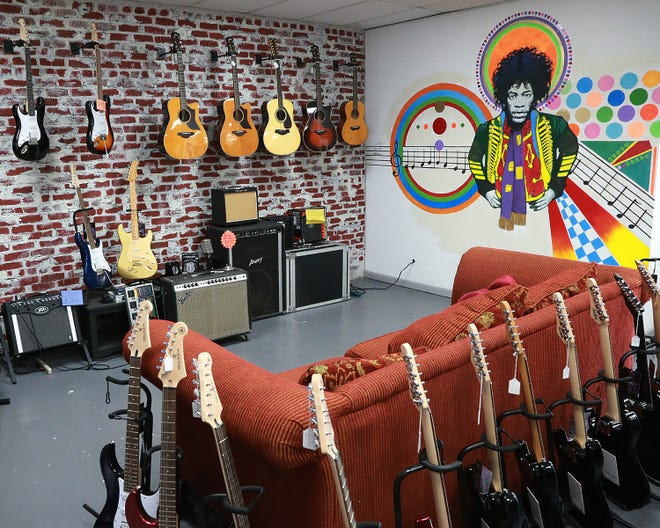 The Ben Jones Music School guitar lounge features a mural of Jimi Hendrix. The school opened last year at 220 Towson Ave. in Fort Smith.