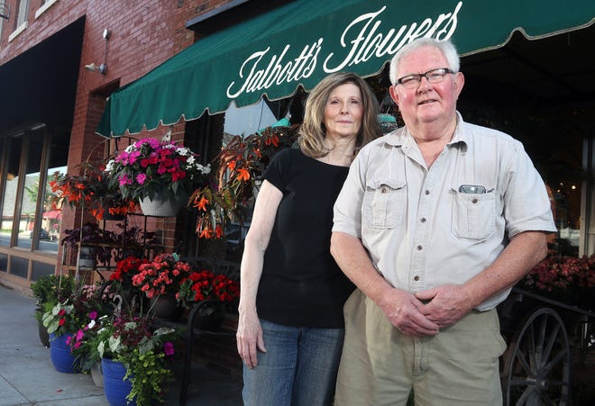 Renea and Dave Talbott stand outside their business, Talbott's Flowers, on June 12 in Uptown Westerville. The business has been family-owned since 1947 and at its current location at 22 N. State St. since 1963.