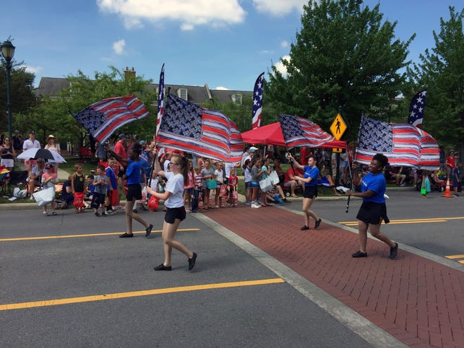 People march in the New Albany Independence Day parade in 2018.