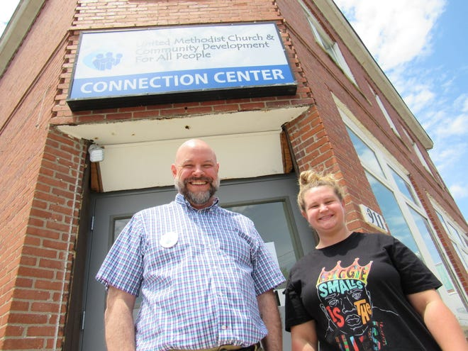 Mike Premo and Andrea Robinson stand in front of the Community Development for All People's Connection Center, which opened in January at 911 Parsons Ave. in Columbus, east of German Village. The center provides a number of services for low-income individuals and families. Premo is director of engagement for CD4AP and Robinson is site coordinator for the center.