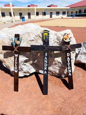 The three crosses made for Willow Sanchez, 11; Sandra Mizer, 13; and Daytona Bronas, 12. The crosses were made by Lucerne Valley Middle/High School Co-Principal Kelly Boeing. They were erected on Camp Rock Road where the girls were hit and killed during a June 5, 2021, hit-and-run crash.