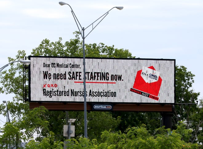 The Registered Nurses Association (RNA) of University of Cincinnati Medical Center promotes its billboard asking for safe staffing in the hospitals. The association and the hospital Wednesday reached a tentative contract.