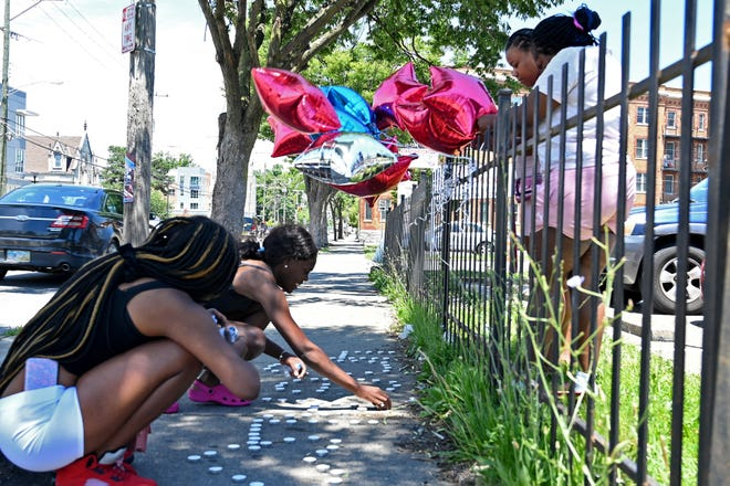 Memorials for juvenile victims are a too-familiar sight. This one for Galevon Beauchamp was set up June 23 after the 16-year-old was shot in North Avondale. He died June 24 from his injuries.