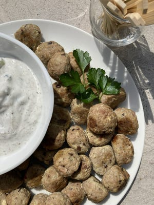Cocktail Greek meatballs with tzatiki sauce.